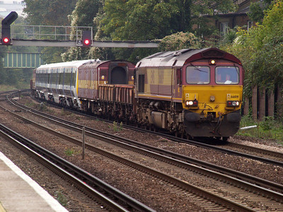 66109 passes Kensington Olympia with a Networker newly refurbished from Wolverton-Slade Green.