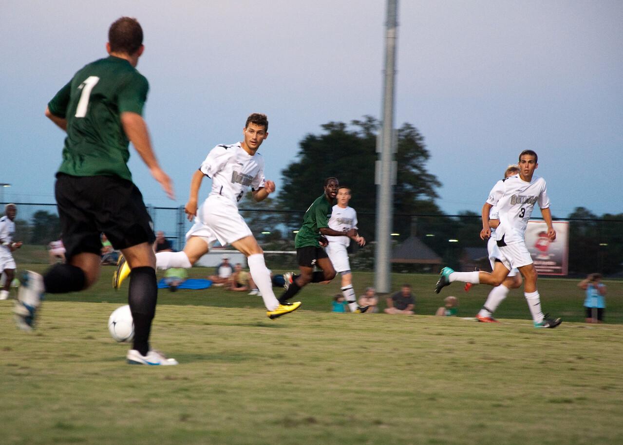 GWU midfielder Adam Augurso (8) and defender Ian Hartfield (3) cut off an attack by USC-Upstate.