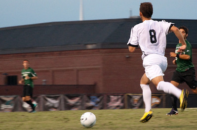 GWU midfielder Adam Augurso (8) looks for an open teammate while moving the ball upfield against USC-Upstate.