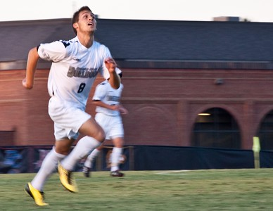 GWU midfielder Adam Augurso (8) looks up the field against USC-Upstate.