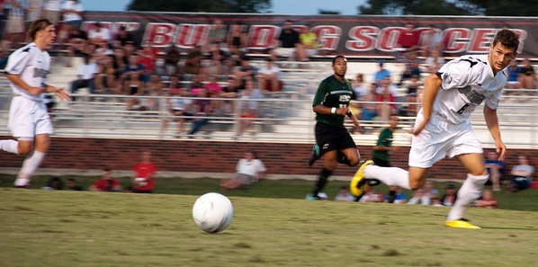 GWU midfielder Adam Augurso (8) looks for the ball against USC-Upstate.