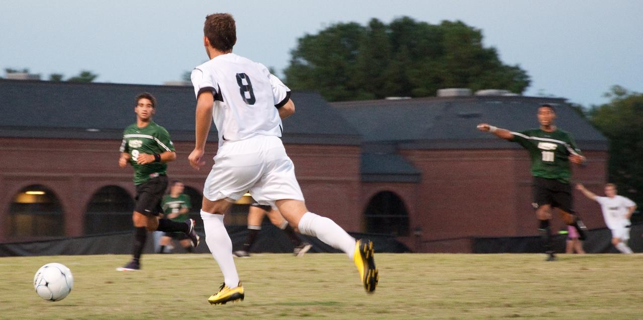 GWU midfielder Adam Augurso (8) moves the ball upfield against USC-Upstate.