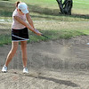 Sandshot: North Central's Anna McClain hits a shot from the sand during early action Friday at The Landing.