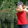 Tee party: Rachel Welker watches her shot on the 14th hole at The Landing golf course Thursday afternoon.