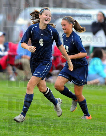 All smiles: Molly Mckee is all smiles after scoring the Patriots' second goal against crosstown rival South. With her is Kathryn Ruark.