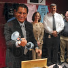 Tribune-Star/Joseph C. Garza<br /> Cleats and shake weights: Vigo County School Corporation Superintendent Dan Tanoos removes another gift from New York Jets punter Steve Weatherford, a shake weight, during a press conference Thursday at the school corporation's headquarters.