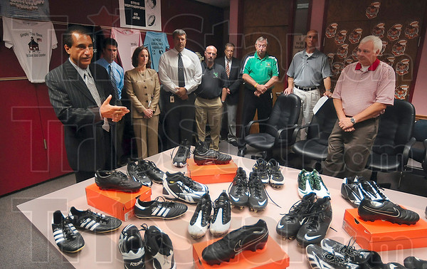 Tribune-Star/Joseph C. Garza<br /> A gift from Steve: Vigo County School Corporation Superintendent Dan Tanoos talks about the donation of football cleats from former Terre Haute North student and New York Jets player Steve Weatherford during a press conference at the school corporation's office Thursday. The cleats were worn by several of Weatherford's teammates, including LaDainian Tomlinson and Mark Sanchez.