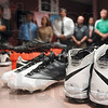 Tribune-Star/Joseph C. Garza<br /> Famous footwear: Cleats that were once worn by New York Jets defensive end Shaun Ellis, marked with a 92, sit on a table on display as Vigo County School Corporation superintendent Dan Tanoos, left, talks about the donated football cleats from former Terre Haute North standout and New York Jets player Steve Weatherford Thursday at the school corporation office.