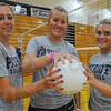All four: Terre Haute North seniors Laura Maurer, Mary Kate Etling and Katelyn Anderson have been starters for their volleyball team their entire time at the school.