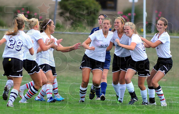 First blood: Terre Haute South teamn members rejoice after their first score against the Patriots Thursday evening in Girls' soccer.  Madison Kesler, third from right(33), scored the goal. Also pictured are: Madison Hughes(29), Sania Wrin(4), Makenzie Mauriello(27), Courtney Hubbard, next to Kesler, Katherine Senseman, far right and other unidentified Braves.