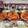 "Tribune-Star/Joseph C. Garza<br /> ""Can"" do attitude: Jim Flanders, Marilyn Flanders and Pastor Carl Leth of the Jasonville United Methodist Backdoor Food Pantry dig into their stacks of hot pancakes as they attend the hunger awareness breakfast Thursday at Ryves Youth Center at Etling Hall."