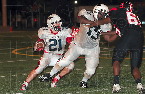 Tribune-Star file photo/Joseph C. Garza<br /> Looking for running room: Terre Haute North's Daniel Gabbard looks for an opening as teammate Jabari Bradshaw  blocks South's Elijah Beard during the Patriots' win Friday, Aug. 27 at Memorial Stadium.