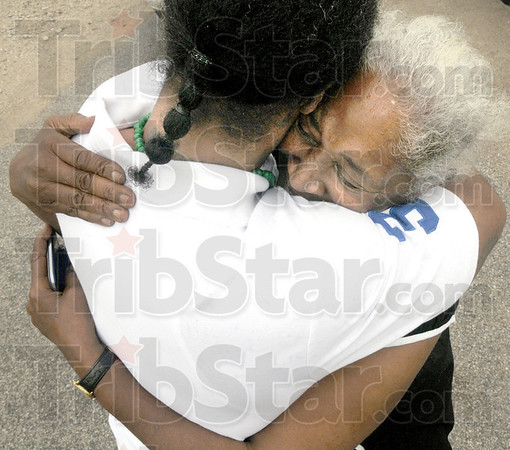 Freedom: Christine Goudy hugs her son for the first time in fifteen years after his relase from prison Thursday afternoon.