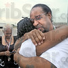 Free: Walter Goudy hugs his fiancee Meeulonda Williams after walking out of the Wabash Valley Correctional Institute Thursday afternoon. Walter's mother Christine is texting at left.