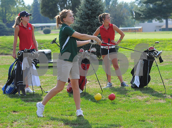 They're off: West Vigo's Ciara McClain tees off with fellow #1 golfers Rachel Welker of Terre Haute North and Caylee Walburn of Terre Haute South.