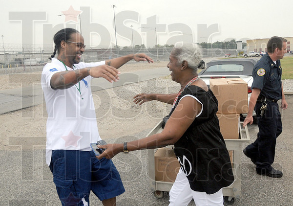 Free man: Walter Goudy is greeted by his mother Christine Goudy as he walks out of the Wabash Valley Correctional Institute Thursday afternoon. This is the first time they have seen one another since his incarceration fifteen years ago.