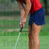 Plunk: Rachel Welker watches her drop for a birdie on the third hole of the County golf meet Thursday evening at The Landing.