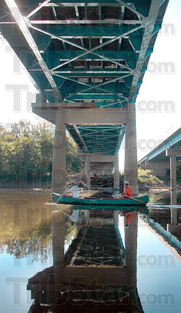 Tribune-Star/Joseph C. Garza<br /> River view: Indiana State professors Eric Anderson and Tom Derrick get a closer look at the underside of the Indiana 63 bridge during a trip up the Wabash River from Fairbanks Park Sunday.