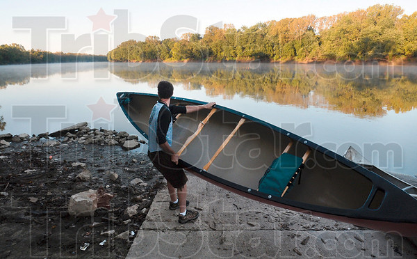 Tribune-Star/Joseph C. Garza<br /> Indiana State senior Doug Buren prepares to place his canoe in the Wabash River before the start of a trip up the river Sunday as part of an effort to raise awareness of the Riverscape and to promote recreation on the river. Buren floated along with Indiana State professors Eric Anderson, Tom Derrick and Jim Speer and Ivy Tech Community College agriculture professor Jim Rosene and fellow ISU student Dorothy Rosene.