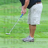 On line: Rich Schelsky watches his putt head to the hole on the back nine at Hulman links Sunday morning.