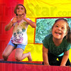 Play time: Maeve Bolin and her cousin Trinity Lewis bounce around at the get together for families with Down Syndrome children Sunday afternoon.