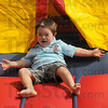 Good times: Zeke Contreras exits the bounce house during the monthly playgroup meeting for parents with Down Syndrome children.