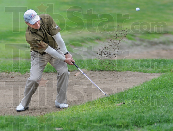 Chip: Ted Kaperak hits a bunker shot during early action of the final round of the Men's City Tournament at Hulman Links Sunday afternoon.