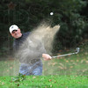 Master blaster: Troy Farris hits a shot from the bunker during action of the City Championship final round at Hulman Links Sunday afternoon.