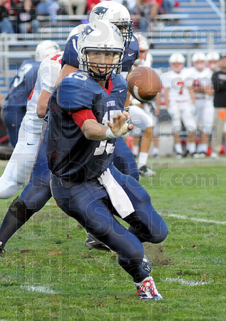 Pitch: North quarterback #15, Chad Holler pitches the ball to Daniel Gabbard during first quarter action against Center Grove Friday night.
