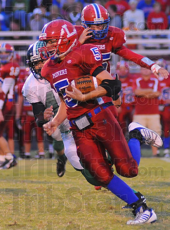 Added spark: Linton runningback Nick Sparks runs past West Vigo defender Ryan Roach.