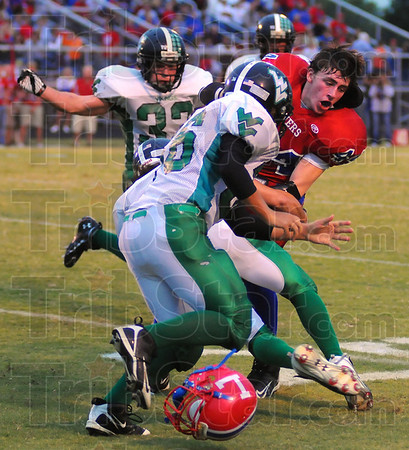 Hard fought: Linton runningback Dane Rupska looses his helmet as he is tackled by Vikings Ethan Boatman(36) and Chase Silcock.