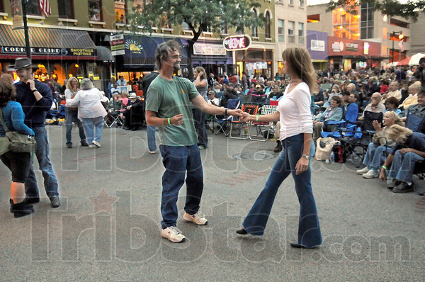 Dancin': Bill Mitchell and his wife Denise Marie Sobieski dance in the street during the opening of the Bluesfest Friday evening.