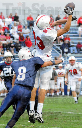 Not: North's #8, Dillion Hare hits Center Grove receiver #83, Joe Reed at the right moment and breaks up the play during first quarter action Friday night.