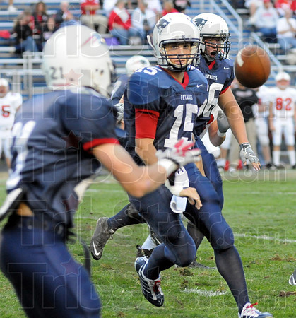 Pitch: North quarterback Chad Holler pitches the ball to #21, Daniel Gabbard during first quarter action against Center Grove Friday night.