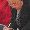 Tribune-Star/Joseph C. Garza<br /> Free from the oppression: Michael Kor signs a letter of forgiveness to the Nazis at the CANDLES Holocaust Museum Friday.