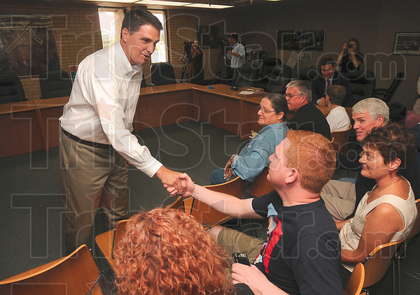Tribune-Star/Joseph C. Garza<br /> Meet and greet: U.S. Rep. Brad Ellsworth shakes hands with Rob Everhart after a senatorial campaign stop press conference Friday at the Terre Haute International Airport.