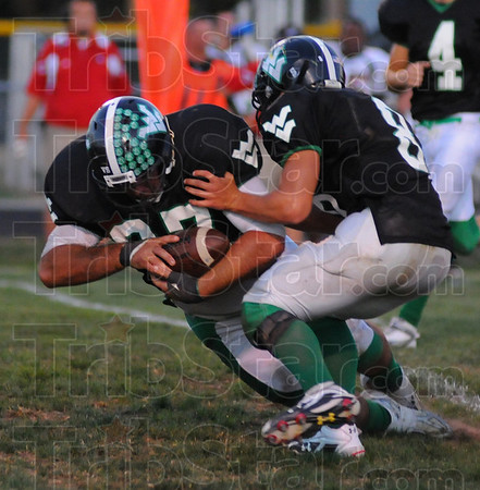 Rumbling: Viking Matt Flesher, playing in the fullback position, rumbles for 16 yards against Edgewood. With him is Dylan Aff.