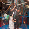 Tribune-Star/Joseph C. Garza<br /> Bubble for two: Duong Ly pulls on the rope to the Bubble Ring exhibit to enclose himself and his daughter, Elva Ly, 3, Friday at the Terre Haute Children's Museum.