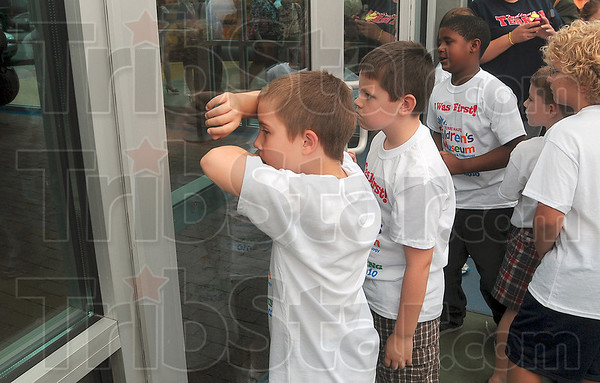 Tribune-Star/Joseph C. Garza<br /> Is it open yet?: DeVaney Elementary third-grader Caleb Foust anxiously waits for the doors to open to the Terre Haute Children's Museum before the grand opening ceremony Friday at the corner of 8th Street and Wabash Avenue.