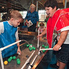 Tribune-Star/Joseph C. Garza<br /> Cooperative science: Makagyn Grimm, 8, and Emile Ponsot, 9, work together to build their own creation in the water exhibit at the Terre Haute Children's Museum Friday.