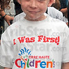 Tribune-Star/Joseph C. Garza<br /> One of the first: DeVaney Elementary third-grader Zachary Van Ness sports a Terre Haute Children's Museum T-shirt Friday before the grand opening ceremony.