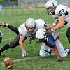 Recovery: Northview's #44, Jessie Miller and #53, Aaron See attack a fumble by North's #7, Charles Dillahunt during first half action. The ball was recovered by See.