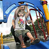 I can do it: Seven-year-old Alexys Fields starts down the slide at the new Union Hospital Pediatric Therapy playground with a little help from Erin Ford Friday afternoon.