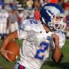 In control: South Putnam quarterback Grant Zimmerman makes good yardage against Rockville.