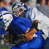 Turnabout: ROckville Runningback Tyler Bradburn is tackled by Eagle defender Grant Zimmerman.