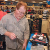 Tribune-Star/Joseph C. Garza<br /> Ready to sell: Bill Ivester, director of operations for Kyvid Enterprises, Inc., removes the security devices from a pile of DVDs at the Blockbuster Video store Friday.