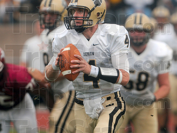 Tribune-Star/Joseph C. Garza<br /> DePauw quarterback Michael Engle looks for an open receiver during the Tigers' win over the Engineers Saturday in Greencastle.