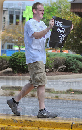 Information: John Martin carries his Terre Haute Truth.com sign in the median of Third street Saturday afternoon.