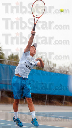 Tribune-Star/Joseph C. Garza<br /> Overhead: Terre Haute North's Chris Holcomb closes in on a short ball to unleash an overhead during his match against a Southmont opponent Saturday at North.