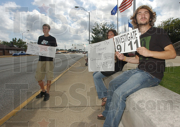 Truth: Dan Corcoran, Blake Gray and Jake Munns of Terre Haute Truth.com hold signs drawing attention to the events of 9/11/2001. They and four others were in front of the Vigo County courthouse for about an hour Saturday afternoon.